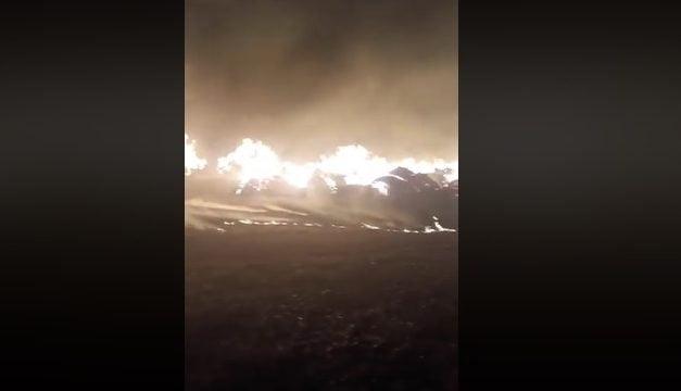 EVENIMENTERĂZBUNARE ÎN STIL MAFIOT?  Ieri a postat imagini cu un drum distrus, azi i-au fost incendiate 300 de tone de furaje VIDEO